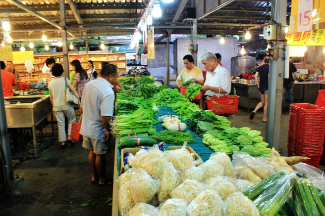 Shopping for veggies at an outdoor market.